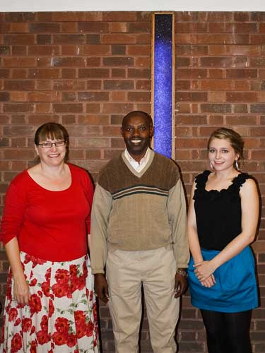 Picture of Bishop Sam from Rwanda with Helen and ELeanor Cooper after the autumn concert