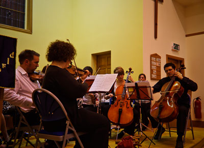 picture of a small orchestra playing music to Handel's Hallelujah Chorus