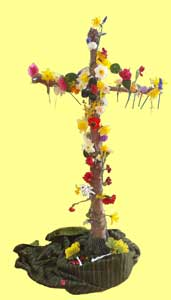 Picture of a Lent Cross now covered with flowers symbolising the new life in Easter