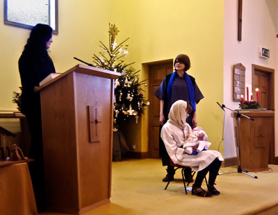 Picture showing a scene from the Nativity 2010 with the Narrator, Joseph, Mary and baby Jesus